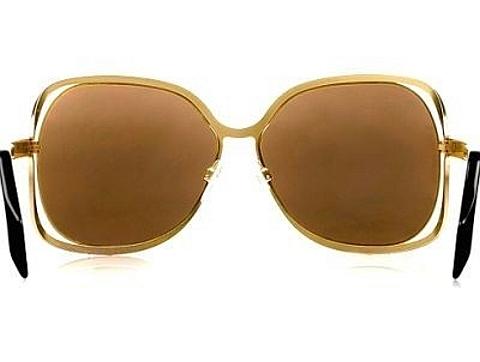 Óculos de sol em ouro